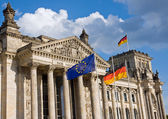 Reichstag with German and European flag — Stock Photo