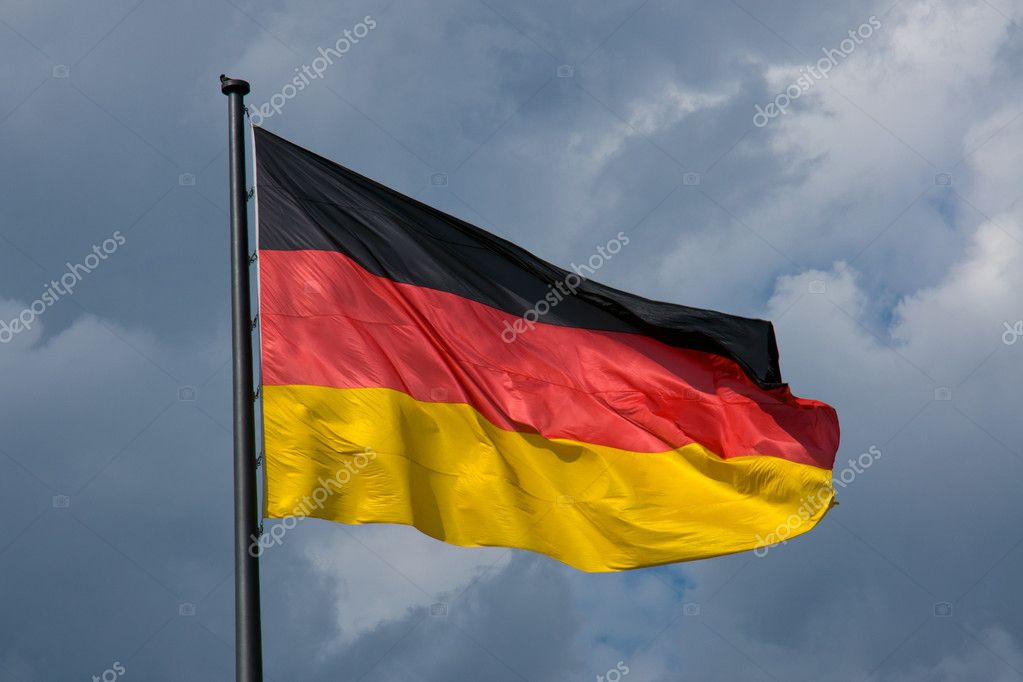 A German flag in front of dark clouds  Stock Photo #5730837