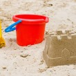 Sandcastle with bucket and shovel — Stock Photo