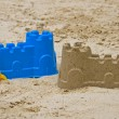 Sandcastle with shovel — Stock Photo