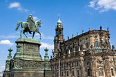 Sculpture and Hofkirche in Dresden — Stock Photo