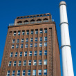Smokestack and brick building — Stock Photo