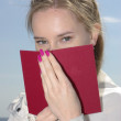 Female covered red book - Stock Photo