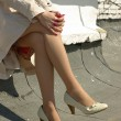 Crossed female legs — Stock Photo