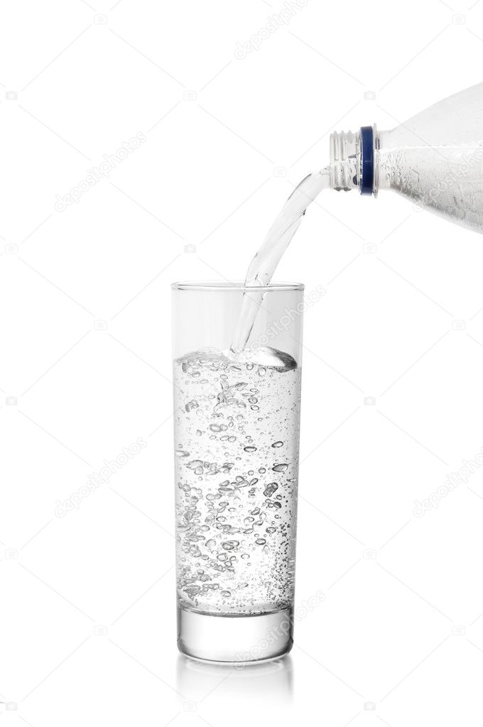 Mineral water in glass isolated on a white  Stock Photo #6393115