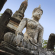 Sukhothai buddha statue temple ruins - Stock Photo