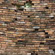 Sagging old brick wall background — Stock Photo