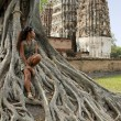 Woman sitting banyan tree sukhothai — Stock Photo #6689634