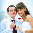 Wedding smile couple with red heart — Stock Photo #5575489