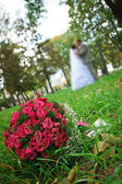Wedding bouquet lying on a green grass — Stock Photo
