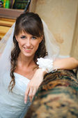 Portrait of the smiling bride in home environment — Photo