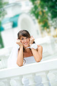 Pensive smiles bride in a white dress has leant the elbows on ha — Stock Photo