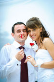 Wedding smile couple with red heart — Stock Photo