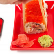 Royalty-Free Stock Photo: Men\'s hand holding sushi