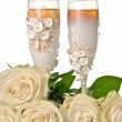 Champagne glass with roses — Stock Photo