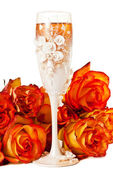 Glass of champagne with flowers — Stock Photo