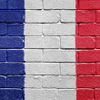 Royalty-Free Stock Photo: Flag of France on brick wall
