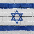 Flag of Israel on brick wall — Stok fotoğraf