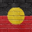 Flag of Aborigines on brick wall - Foto Stock