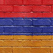 Flag of Armenia on brick wall — Stok fotoğraf