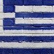 Flag of Greece on a brick wall — Stok fotoğraf
