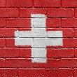 Flag of Switzerland on a brick wall - Stockfoto