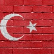 Flag of Turkey on a brick wall — ストック写真