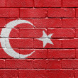 Flag of Turkey on a brick wall — Stock fotografie