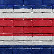 Flag of Costa Rica on brick wall — Stock Photo