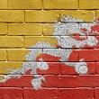 Flag of Bhutan on brick wall - Stockfoto