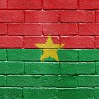 Flag of Burkina Faso on brick wall — Stockfoto