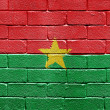 Flag of Burkina Faso on brick wall - Stock Photo