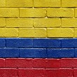 Flag of Colombia on brick wall -  