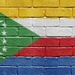 Flag of Comoros on brick wall — Stockfoto