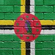 Flag of Dominica on brick wall - Stock Photo