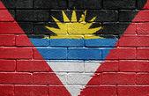 Flag of Antigua and Barbuda on brick wall — Stock Photo