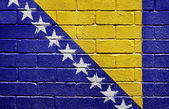 Flag of Bosnia and Herzegovina on brick wall — Stock Photo
