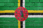 Flag of Dominica on brick wall — Stock Photo