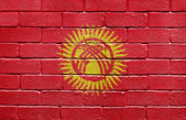 Flag of Kyrgyzstan on brick wall — Stock Photo
