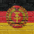 Flag of East Germany on brick wall — Foto Stock