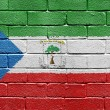 Flag of Equatorial Guinea on brick wall - Stock Photo