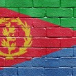 Flag of Eritrea on brick wall — Stock Photo