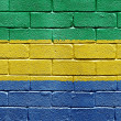 Flag of Gabon on brick wall — Lizenzfreies Foto
