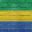 Flag of Gabon on brick wall — Stock fotografie