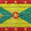 Flag of Grenada on brick wall — Stok fotoğraf