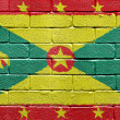 Photo: Flag of Grenada on brick wall