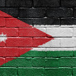 Flag of Jordan on brick wall — Stock fotografie