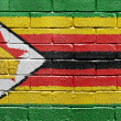 Flag of Zimbabwe on brick wall - Stock Photo