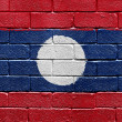 Flag of Laos on brick wall — Stok fotoğraf
