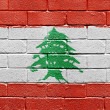 Flag of Lebanon on brick wall — Stok fotoğraf